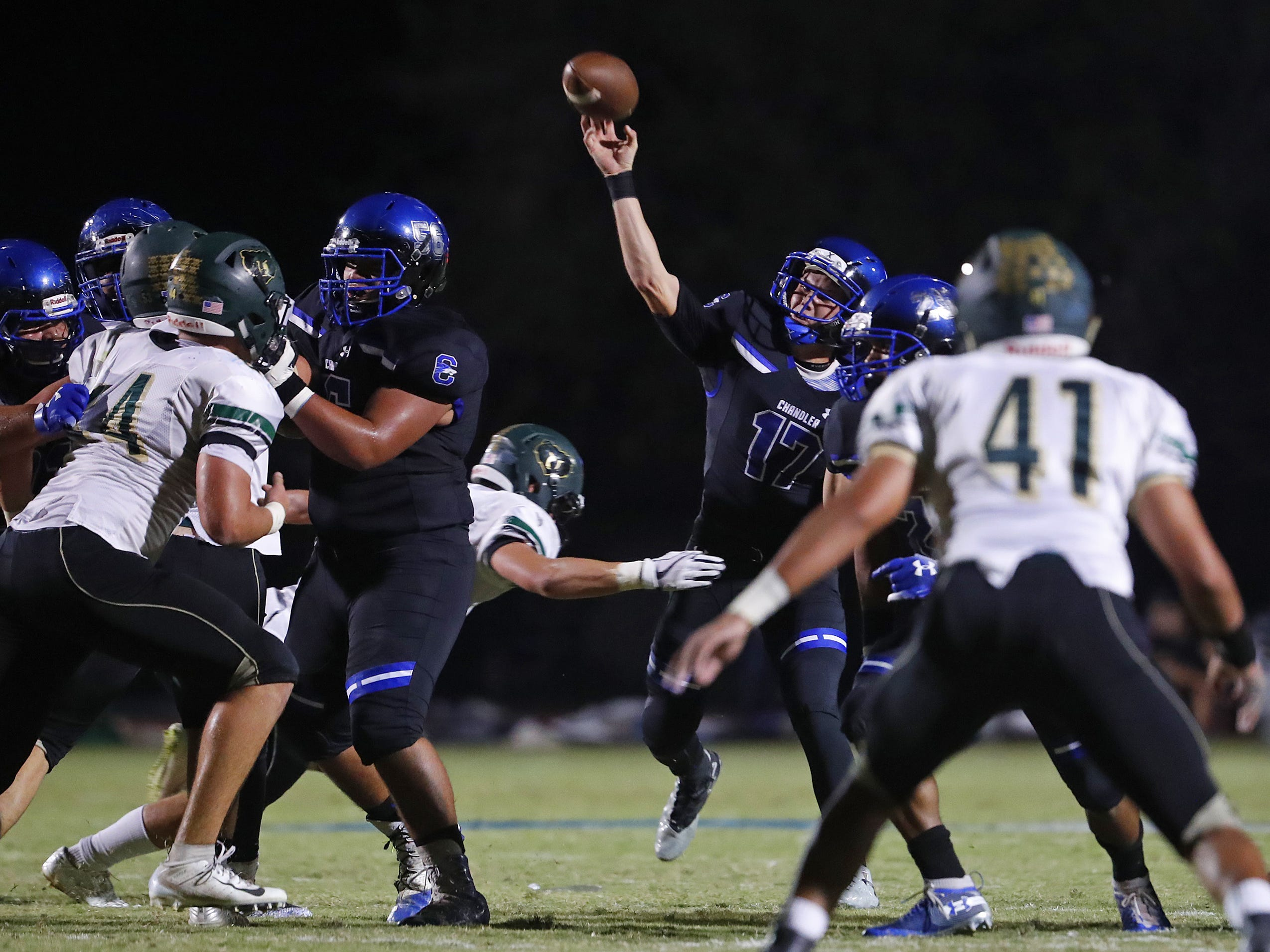 Chandler's Jacob Conover (17) throws a pass against Basha at Chandler High School in Chandler, Ariz. on October 12, 2018.