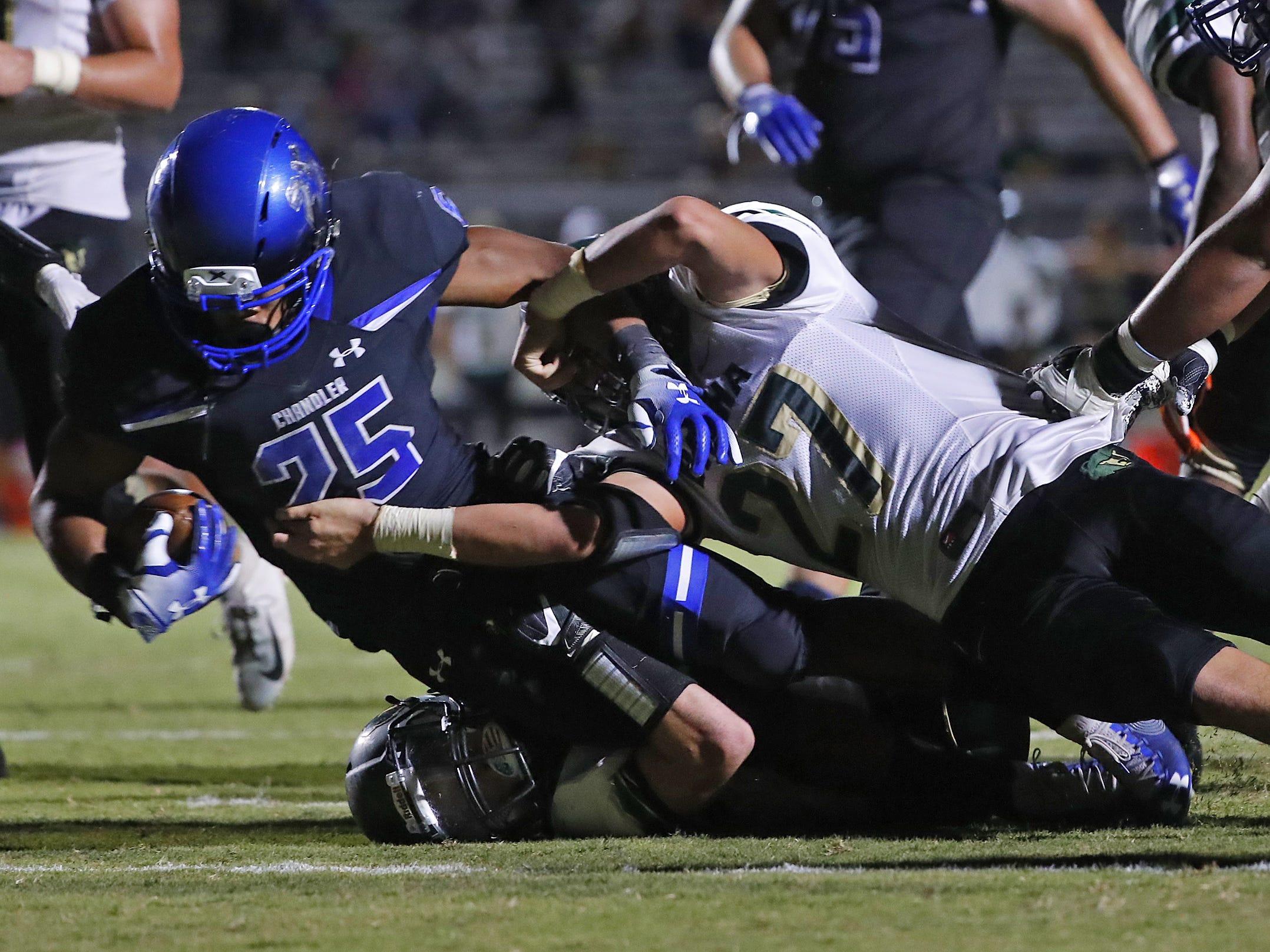 Chandler DeCarlos Brooks (25) scores a touchdown against Basha at Chandler High School in Chandler, Ariz. on October 12, 2018.