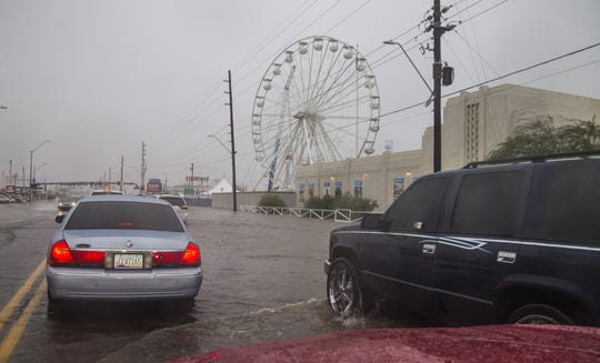 Rain hits the valley flooding streets in Phoenix on October 13, 2018.