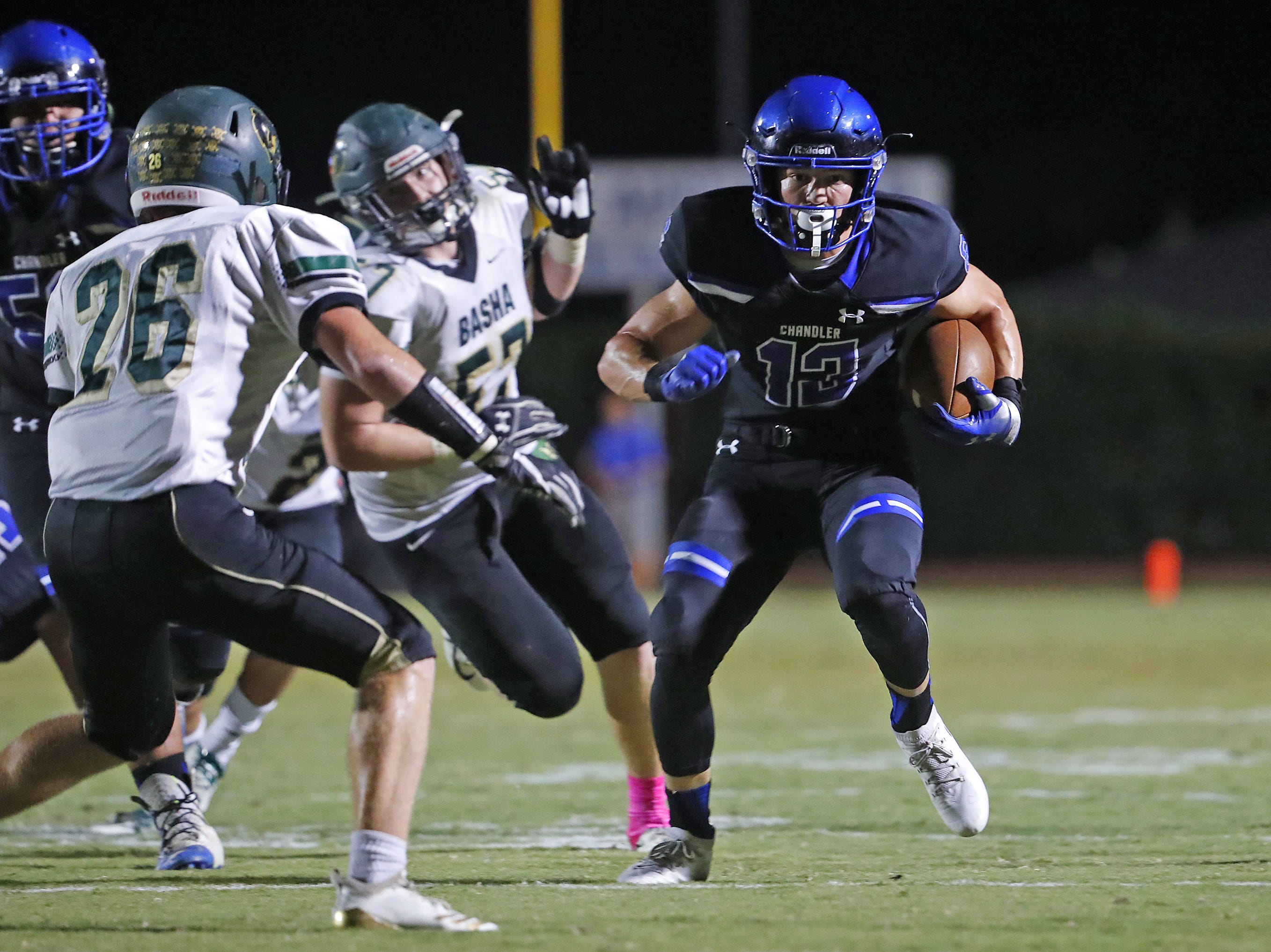 Chandler's Gunner Maldanado (13) runs down field against Basha at Chandler High School in Chandler, Ariz. on October 12, 2018.
