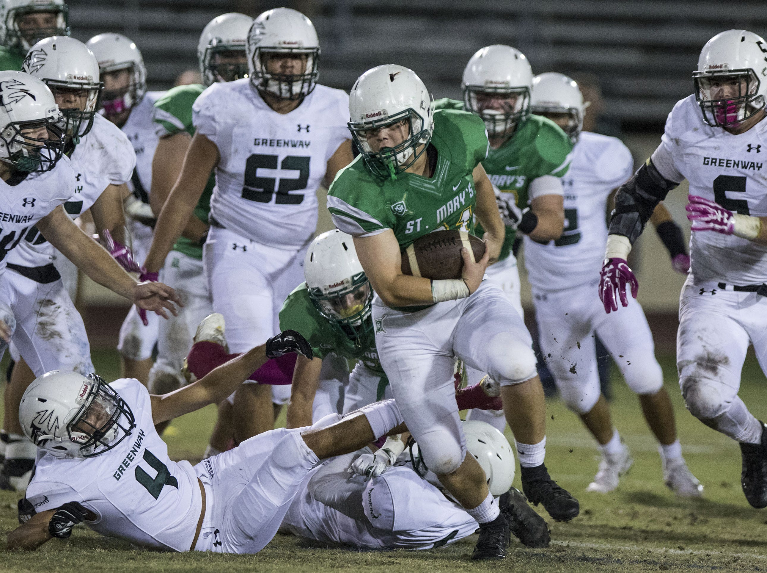 St. Mary's Adam Baratta gets a first down against Greenway during their game at Phoenix College in Phoenix Friday, Oct. 12, 2018. #azhsfb