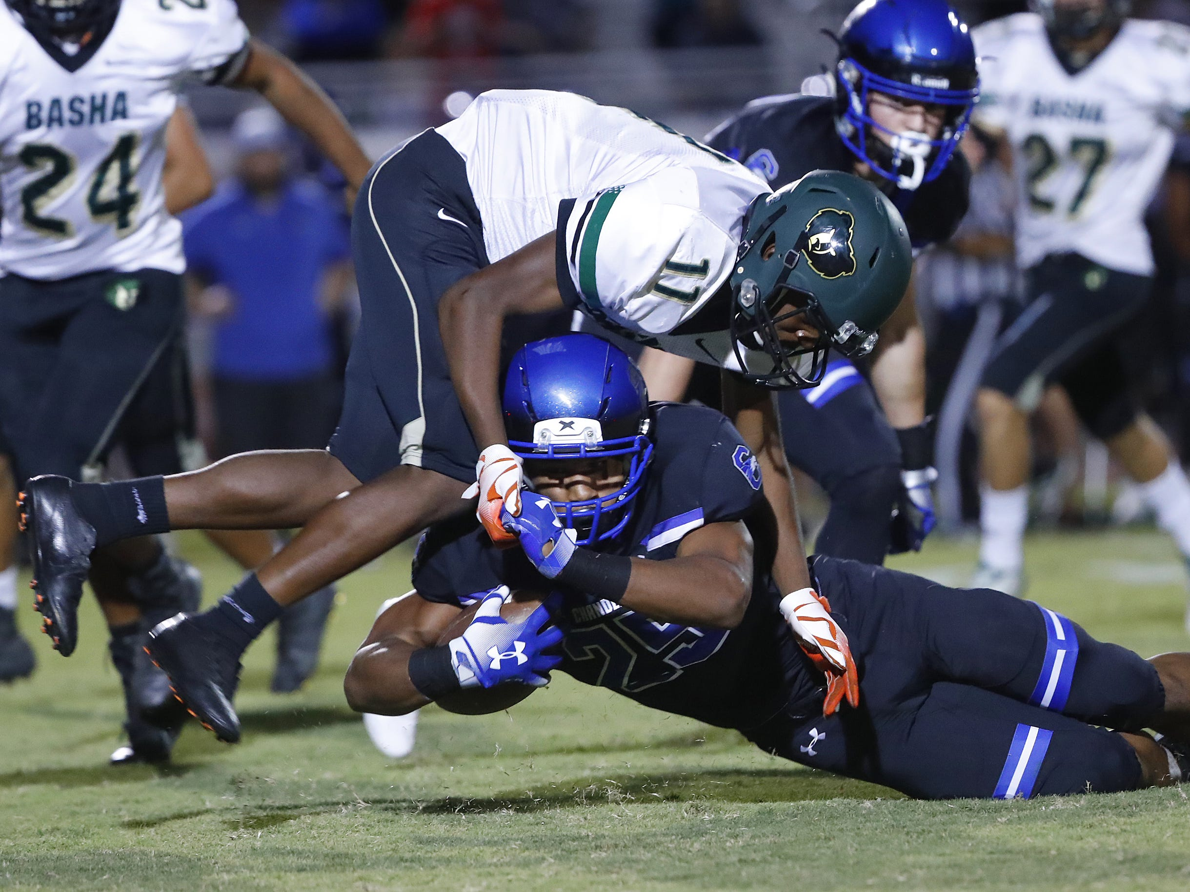 Basha's Andrell Barney (11) tackles Chandler's DeCarlos Brooks (25) at Chandler High School in Chandler, Ariz. on October 12, 2018.