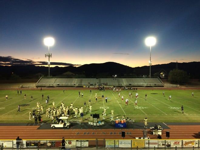 The sun sets before Desert Vista's game against Boulder Creek on Friday night at Desert Vista High School on Oct. 12, 2018. #azhsfb
