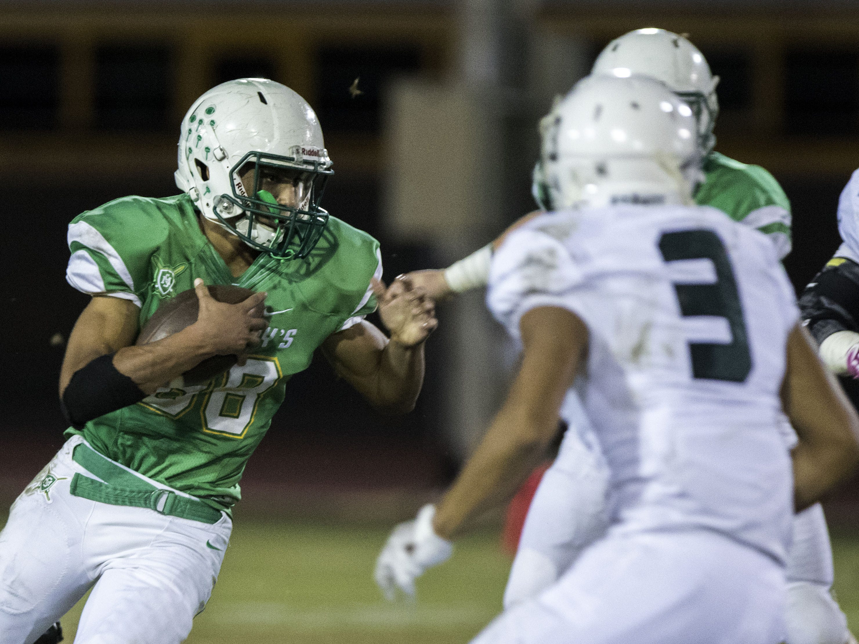St. Mary's Sam Bryant looks for running room against Greenway during their game at Phoenix College in Phoenix Friday, Oct. 12, 2018. #azhsfb