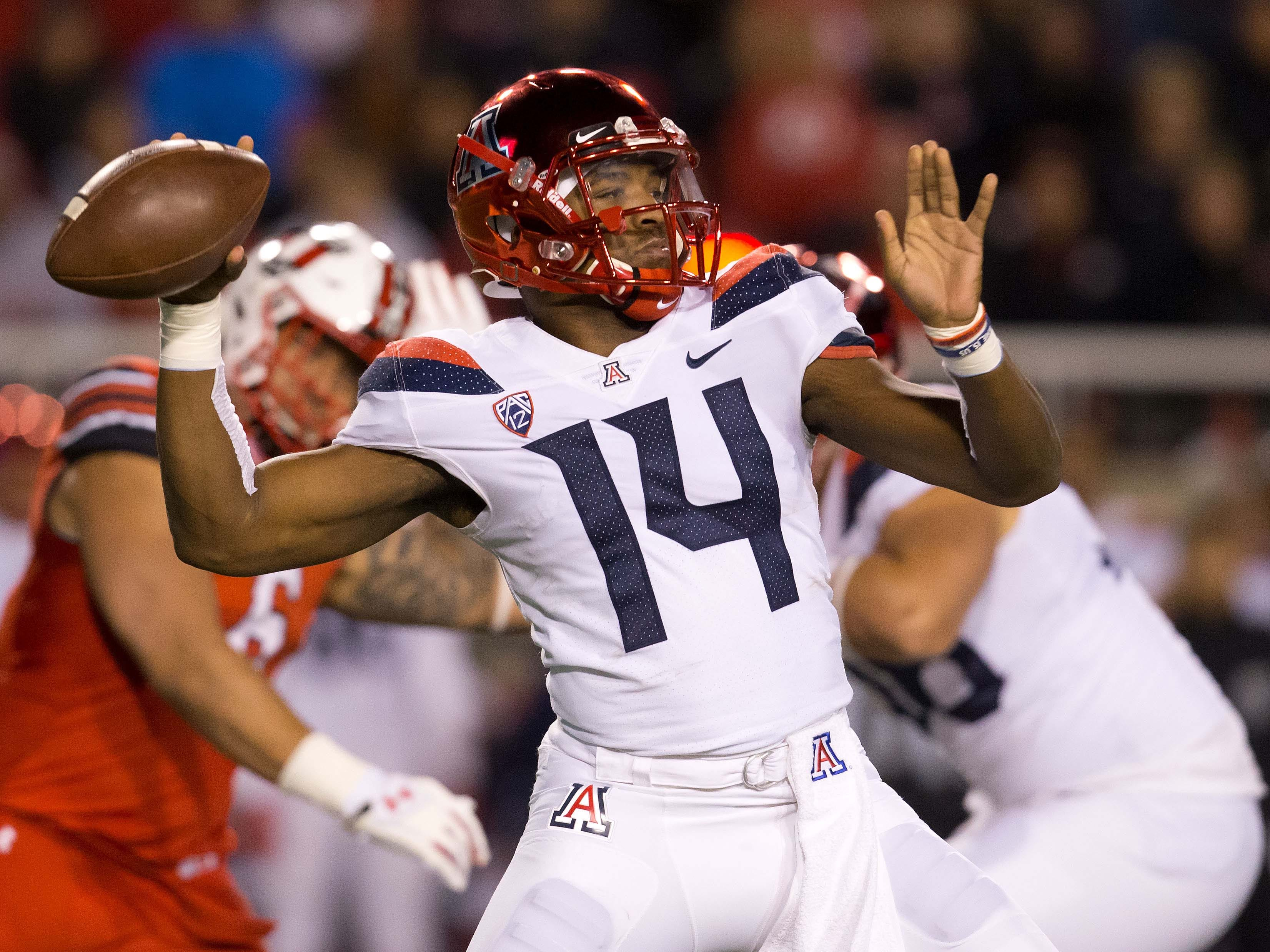 Oct 12, 2018; Salt Lake City, UT, USA; Arizona Wildcats quarterback Khalil Tate (14) passes the ball during the first quarter against the Utah Utes at Rice-Eccles Stadium.