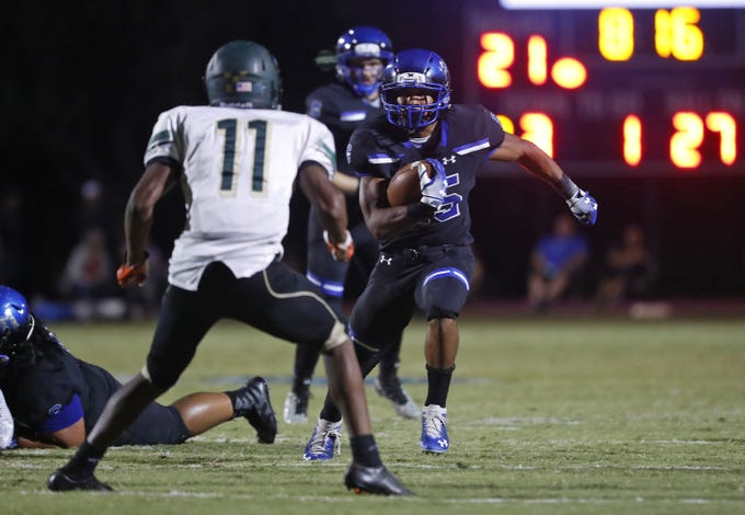 Chandler's DeCarlos Brooks (25) runs downfield into Basha's Andrell Barney (11) at Chandler High School in Chandler, Ariz. on October 12, 2018.