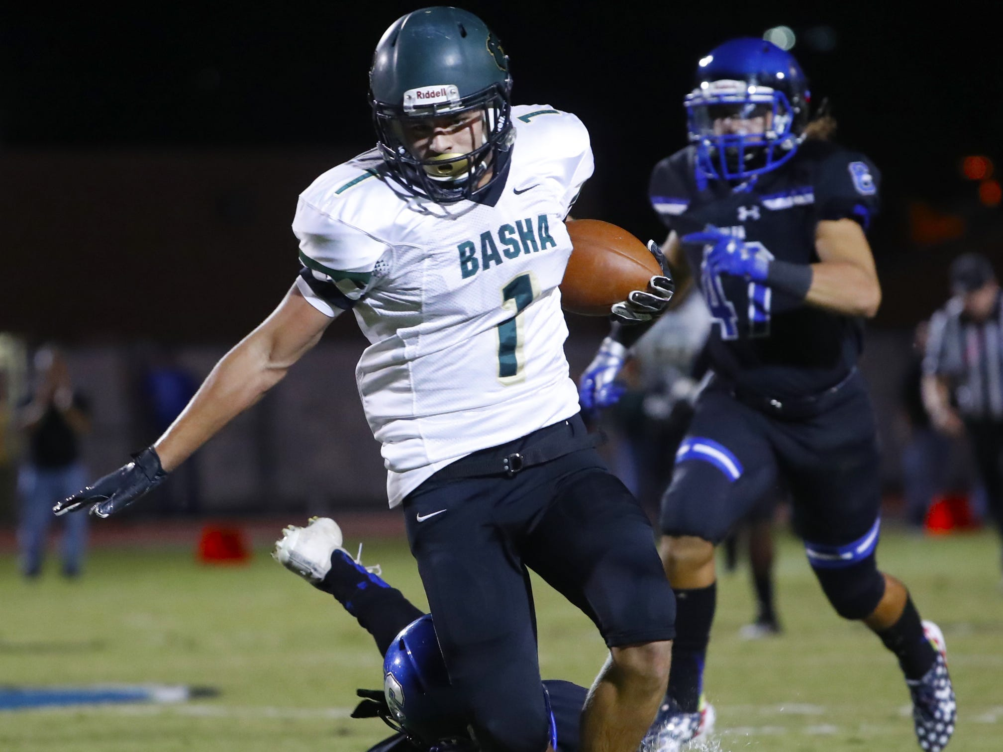 Basha's Ty Siffermann (1) breaks a tackle from a Chandler defender at Chandler High School in Chandler, Ariz. on October 12, 2018.