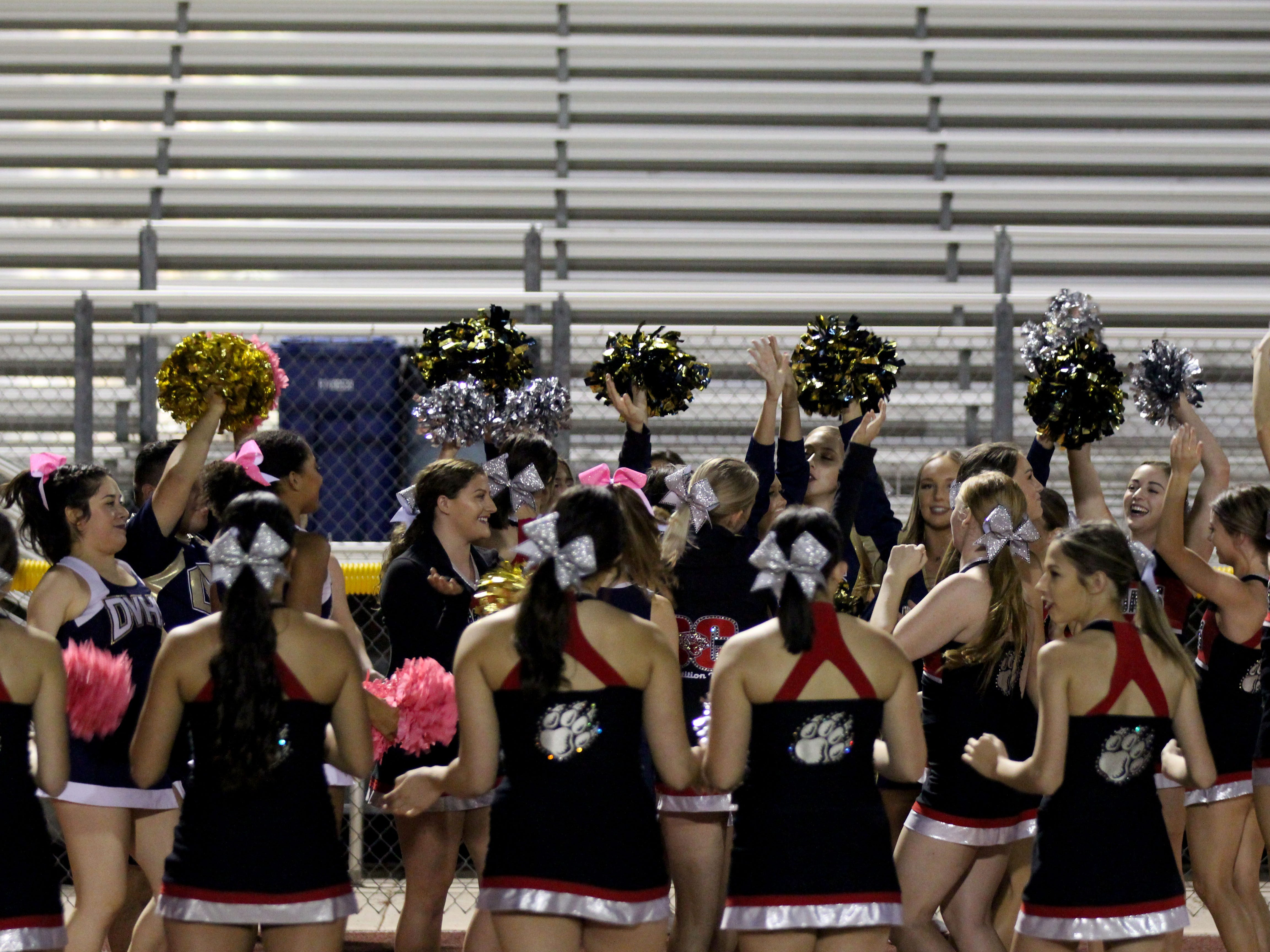 Desert Vista and Boulder Creek cheerleaders sign and dance before the game on Friday night at Desert Vista High School on Oct. 12, 2018. #azhsfb