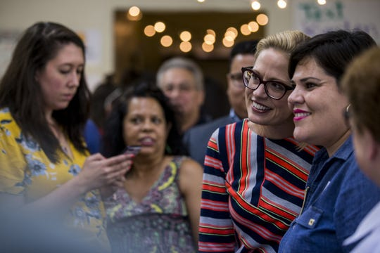 Kyrsten Sinema greets volunteers and supporters on Oct. 3, 2018, at a Democratic field office in Glendale.