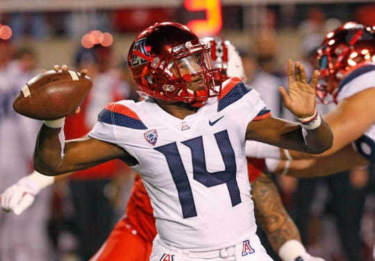 Arizona quarterback Khalil Tate throws a pass against Utah during the first half of an NCAA college football game Friday, Oct. 12, 2018, in Salt Lake City.