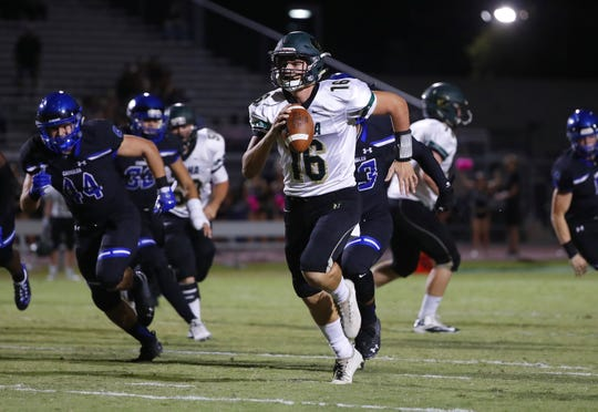 Basha's Gabe Friend (16) scrambles for a touchdown against Chandler at Chandler High School in Chandler, Ariz. on October 12, 2018.