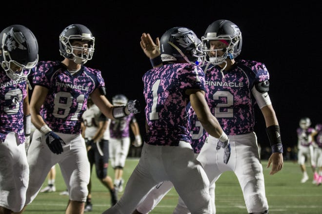Pinnacle's Spencer Rattler celebrates with Kaleb Covington after Covington scored a touchdown against Liberty in the 2nd quarter on Friday, Oct. 12, 2018, at Pinnacle High School in Phoenix.  #azhsfb