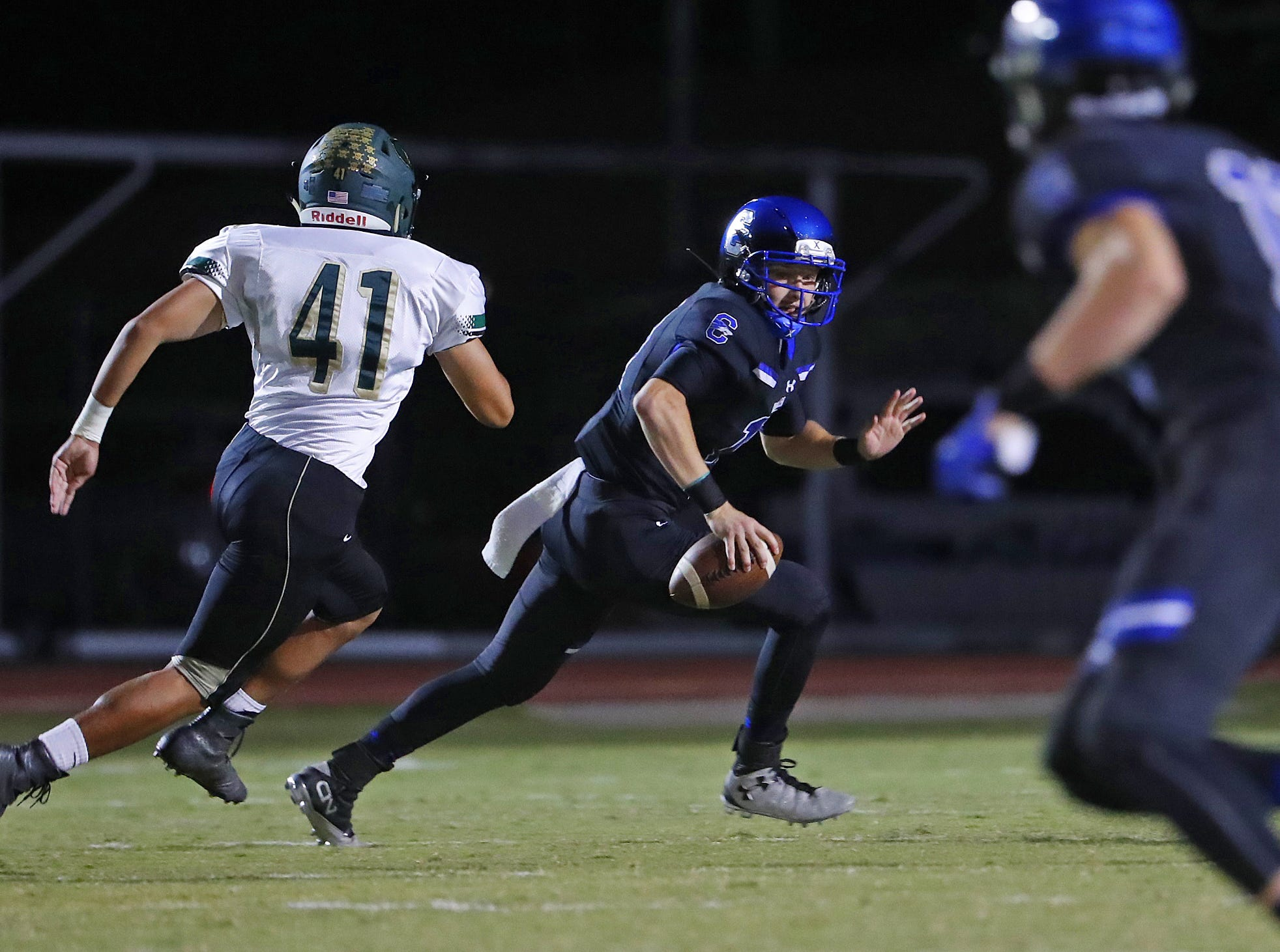 Basha's Charles Gilbert (41) chases down Chandler quarterback Jacob Conover (17) at Chandler High School in Chandler, Ariz. on October 12, 2018.
