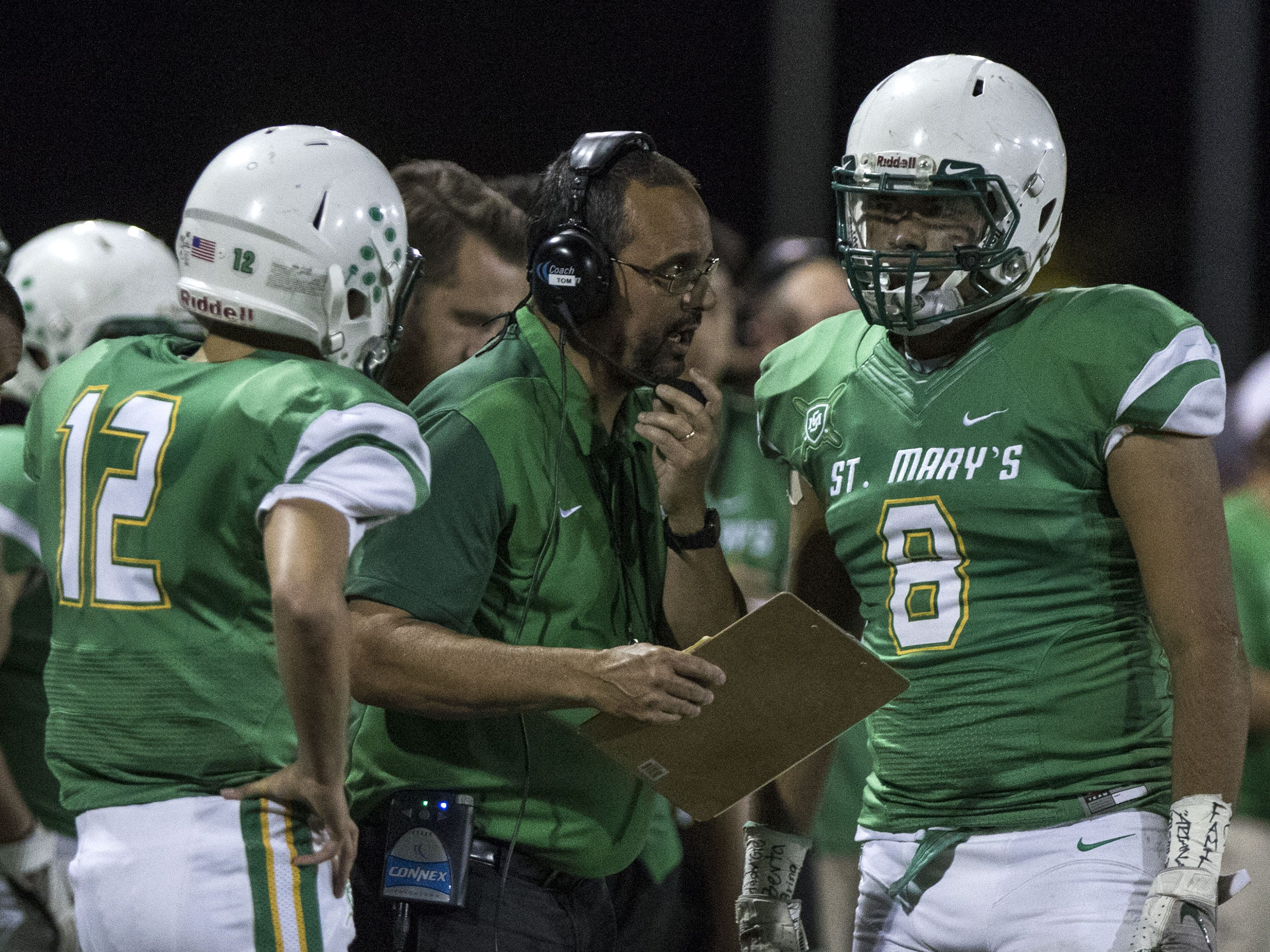 St. Mary's coach Tom Brittain calls a play against Greenway at Phoenix College in Phoenix Friday, Oct. 12, 2018. #azhsfb