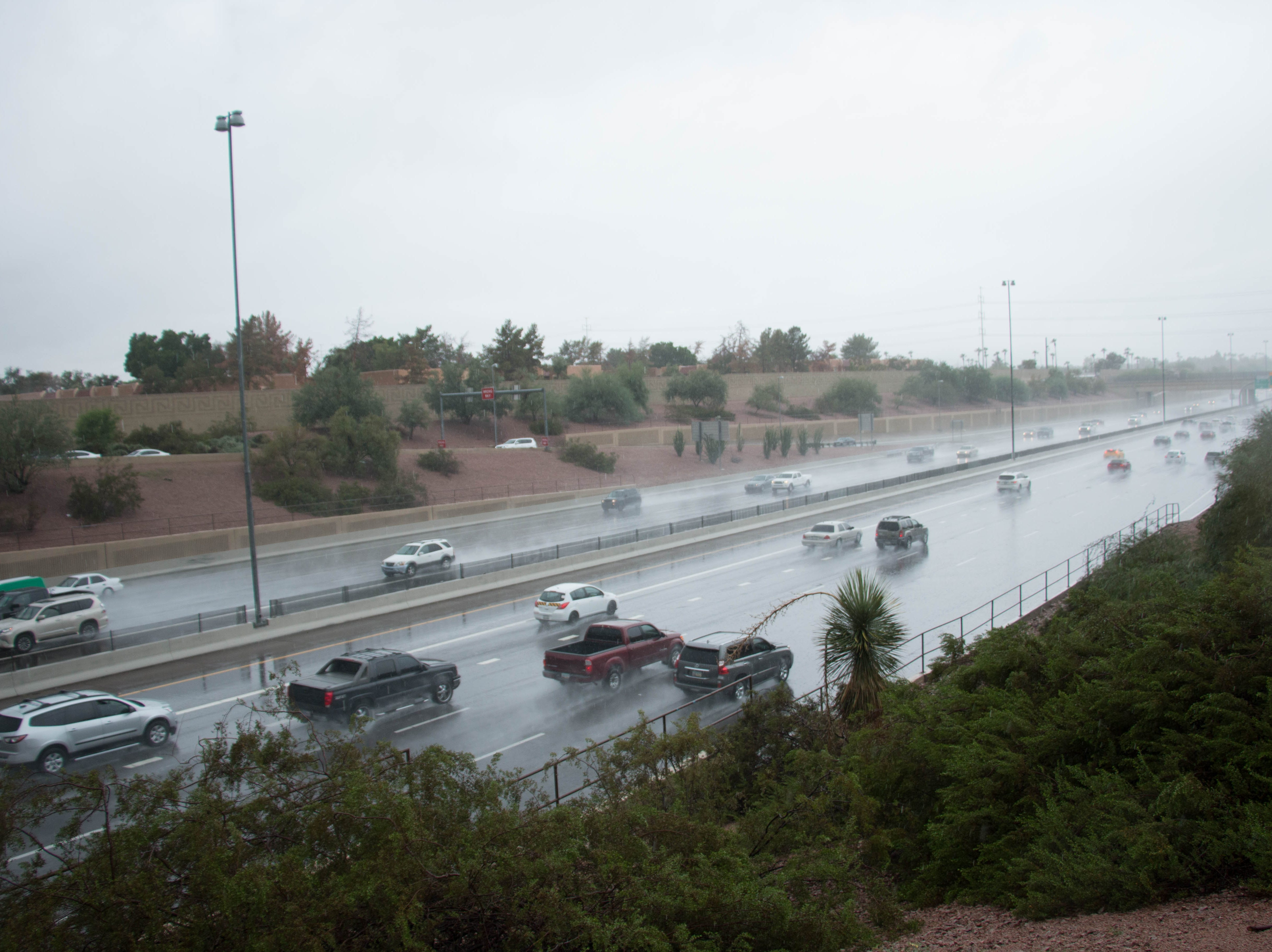 Traffic slows on Interstate 10 from rain from the remnants of Hurricane Sergio.