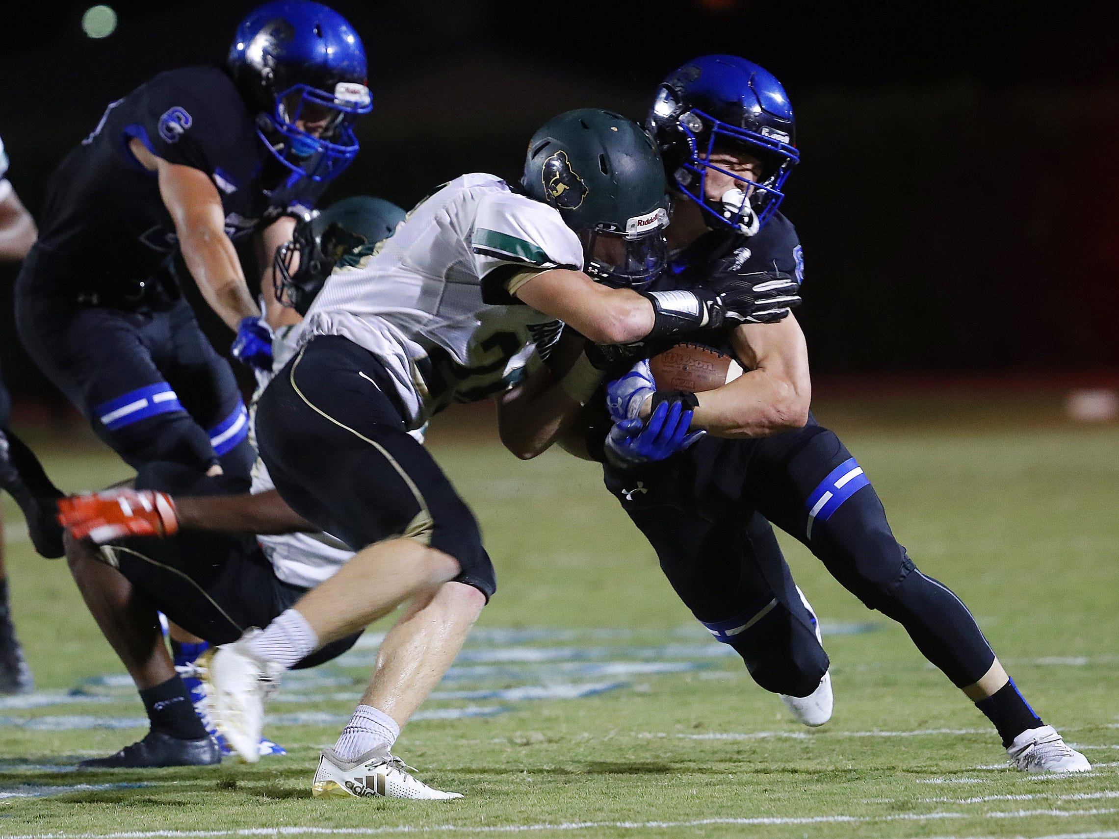 Basha's Dylan Quinn (25) tackles Chandler's Gunner Maldanado (13) at Chandler High School in Chandler, Ariz. on October 12, 2018.
