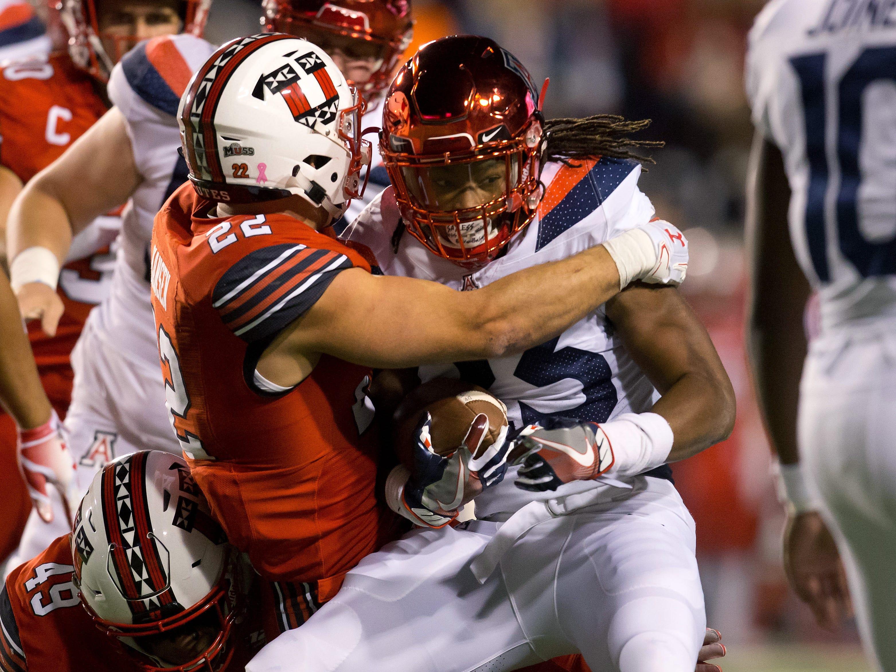 Oct 12, 2018; Salt Lake City, UT, USA; Arizona Wildcats running back Gary Brightwell (23) is tackled by Utah Utes linebacker Chase Hansen (22) during the first half at Rice-Eccles Stadium.