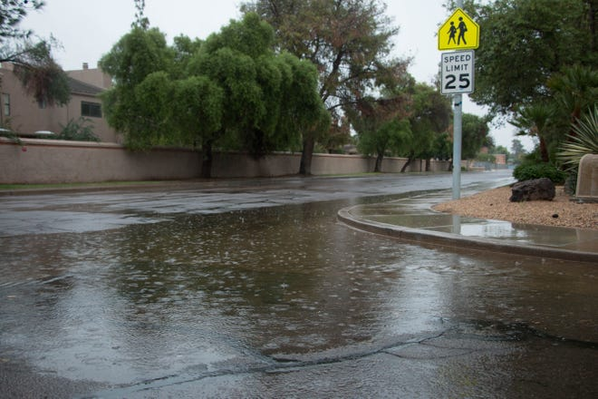 Rain puddles on streets in a Tempe neighborhood  Saturday morning.