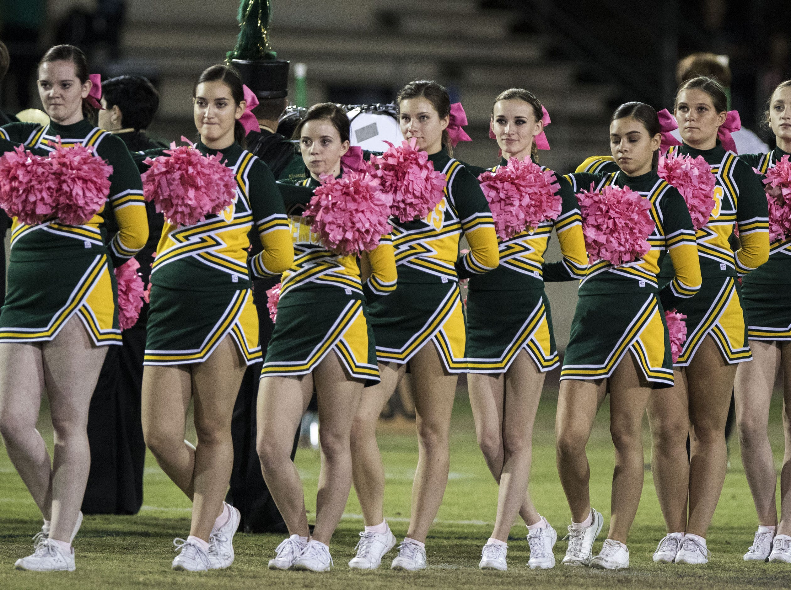 Greenway cheerleaders stand during the National Anthem before their game with St. Mary's at Phoenix College in Phoenix Friday, Oct. 12, 2018. #azhsfb