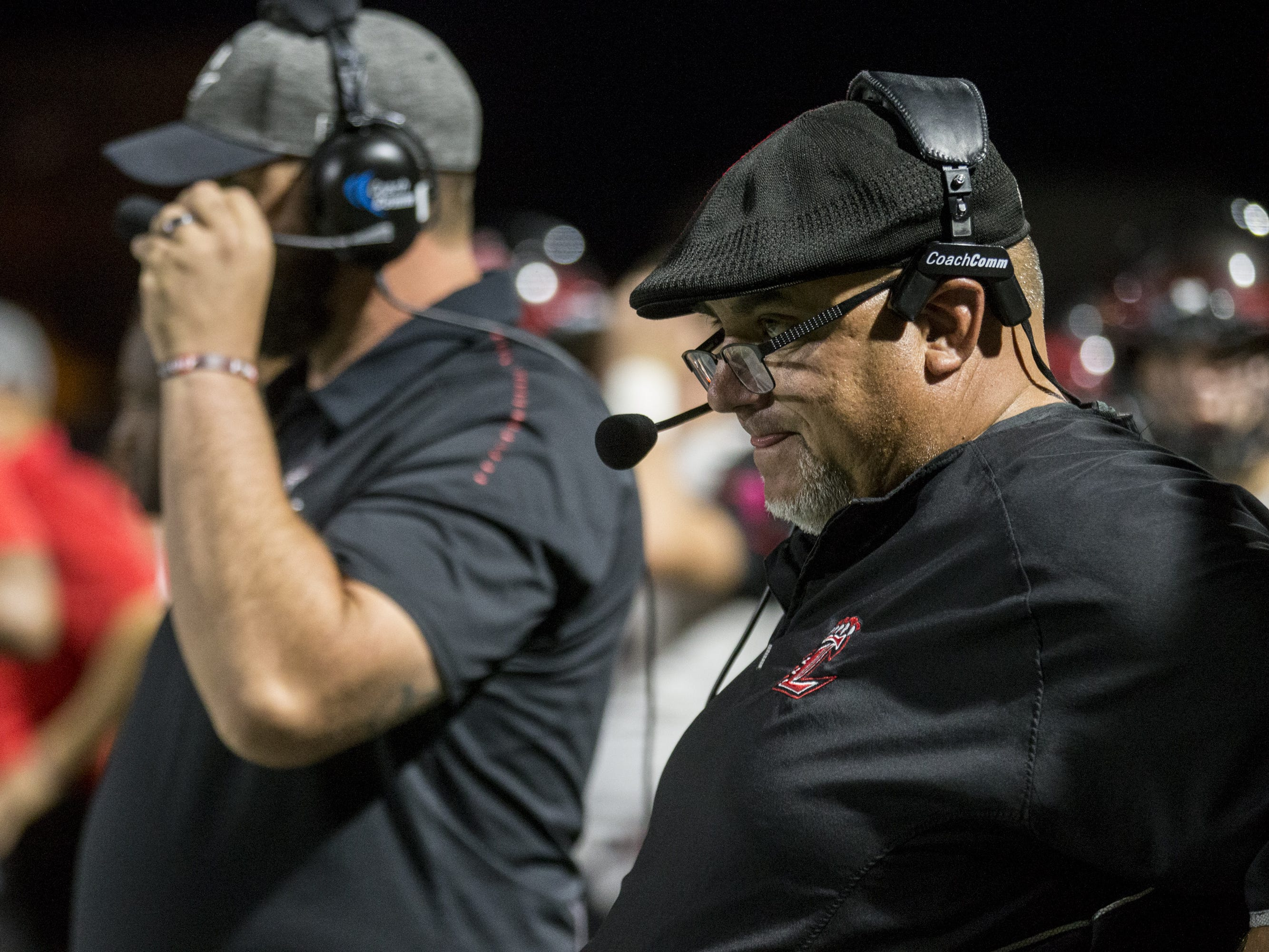Liberty head coach Mark Smith watches during the game against Pinnacle on Friday, Oct. 12, 2018, at Pinnacle High School in Phoenix.  #azhsfb