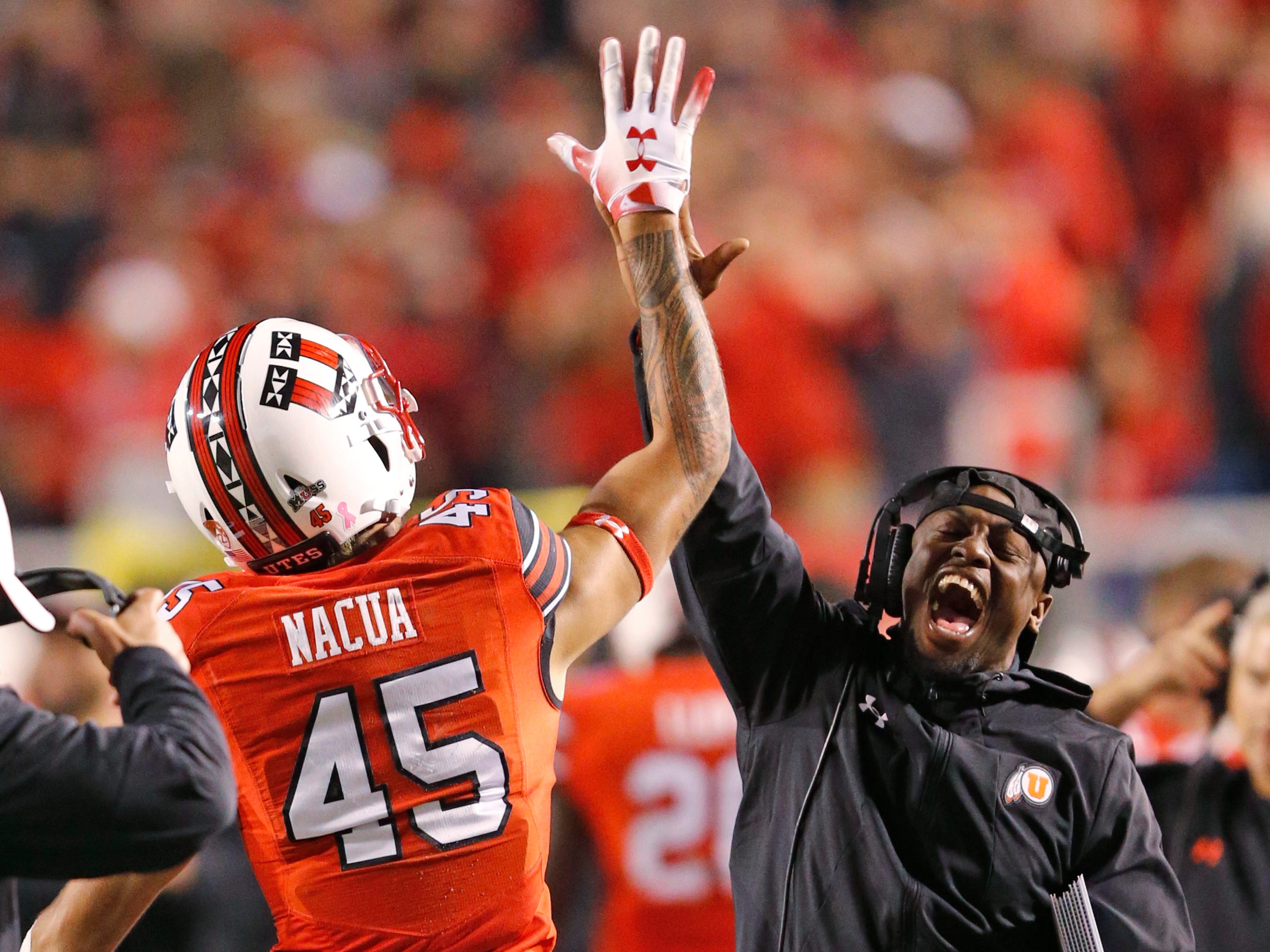 Utah wide receiver Samson Nacua (45) receives a high-five after scoring against Arizona during the first half of an NCAA college football game Friday, Oct. 12, 2018, in Salt Lake City.