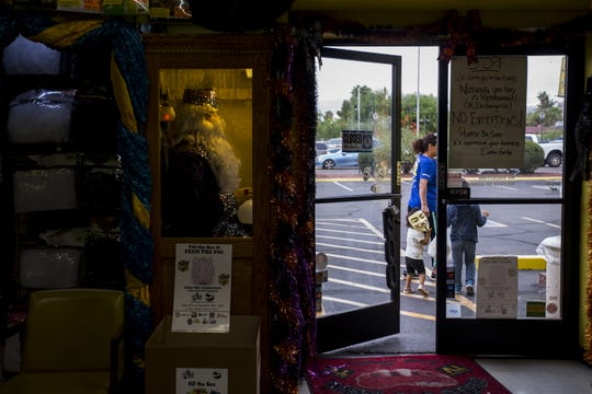 Martha Otero leaves with her children, George, 6, and Jocelyn, 2, at Easley's Fun Shop on Thursday, Oct. 11, 2018, in Phoenix. The costume and gag store is closing at the end of the year after operating for 72 years.