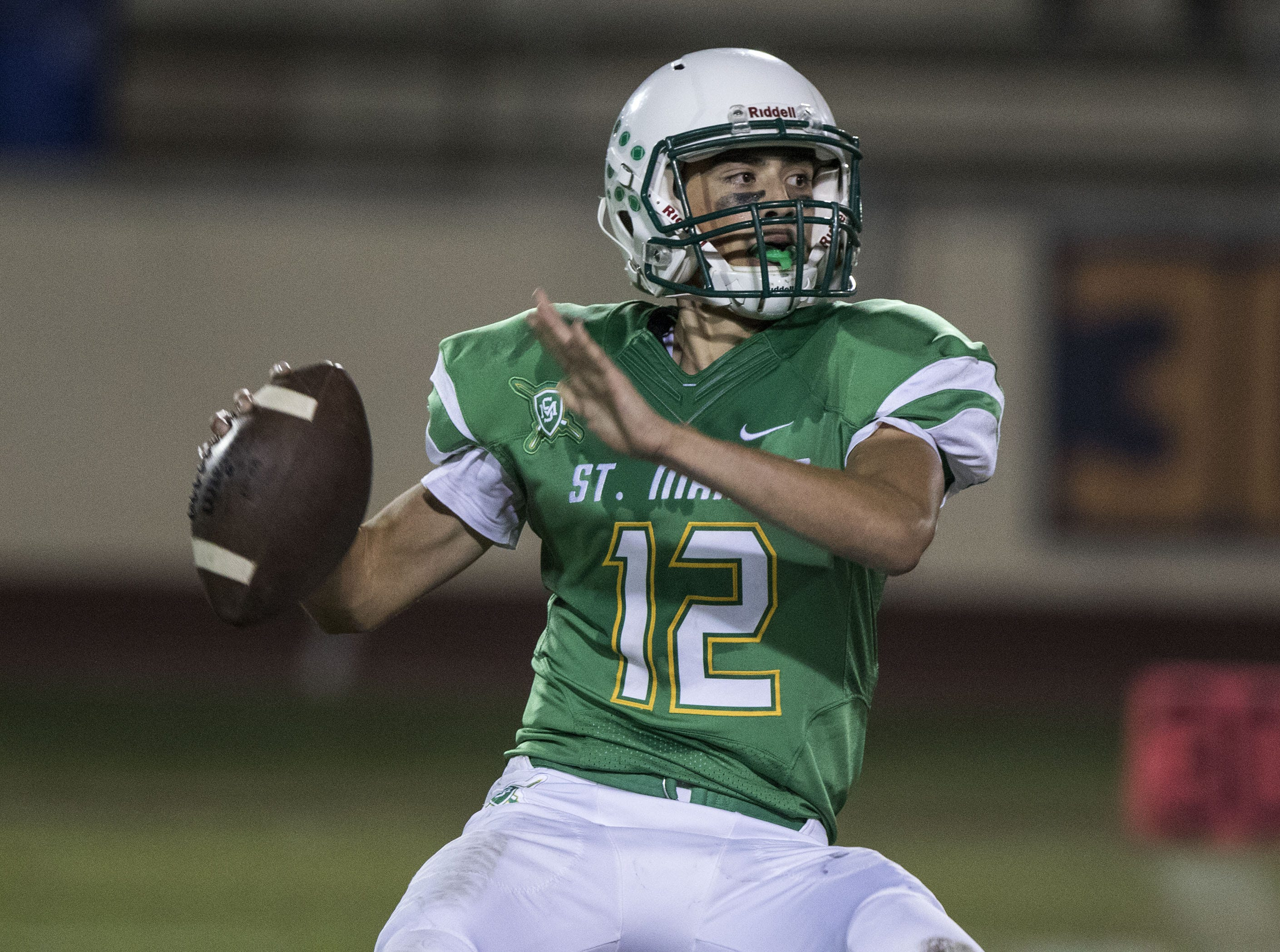St. Mary's Alex Pacheco looks to throw against Greenway during their game at Phoenix College in Phoenix Friday, Oct. 12, 2018. #azhsfb