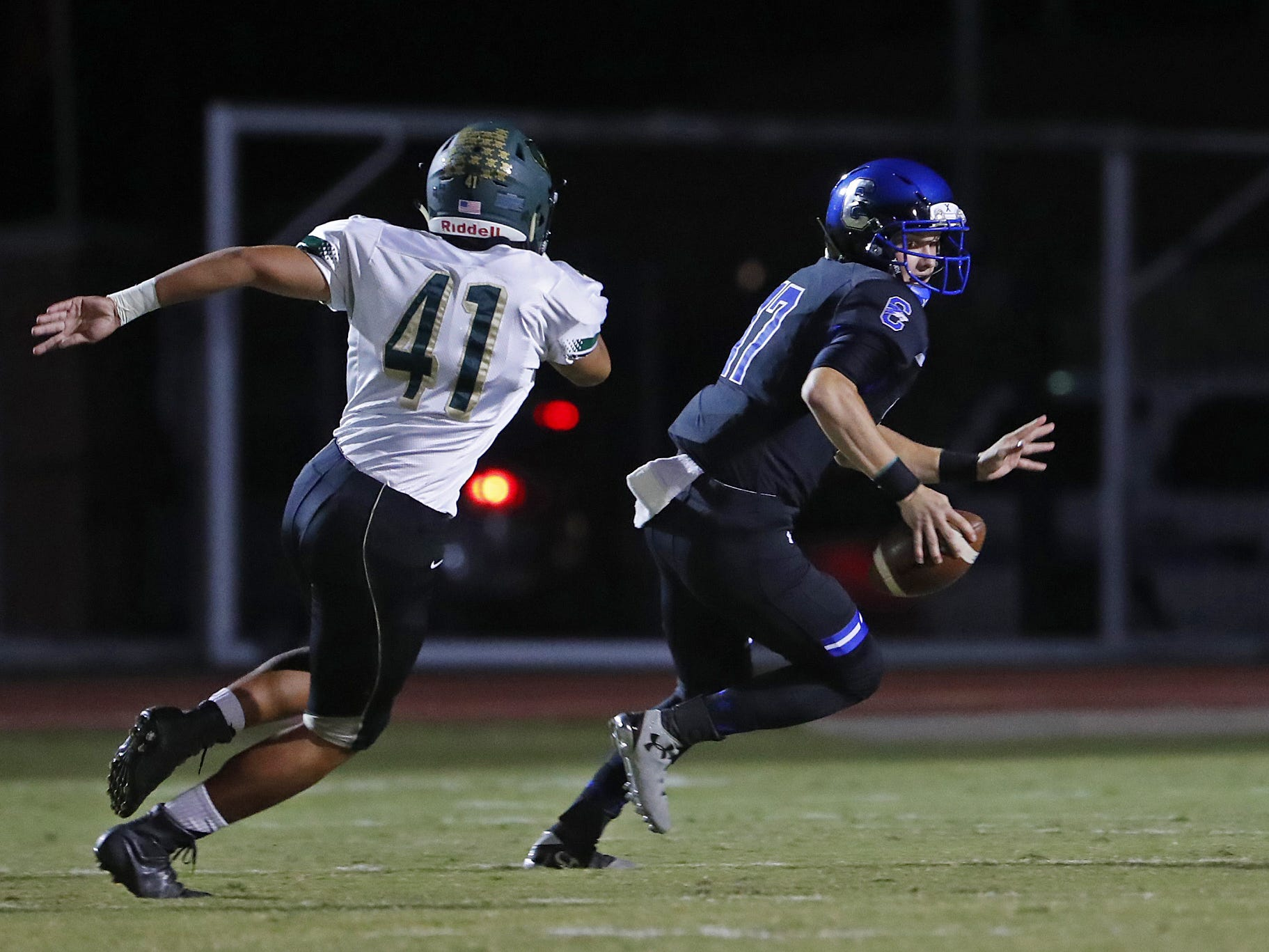 Basha's Charles Gilbert (41) chases down Chandler quarterback Jacob Conover (17) at Chandler High School in Chandler, Ariz. on October 12, 2018. #azhsfb