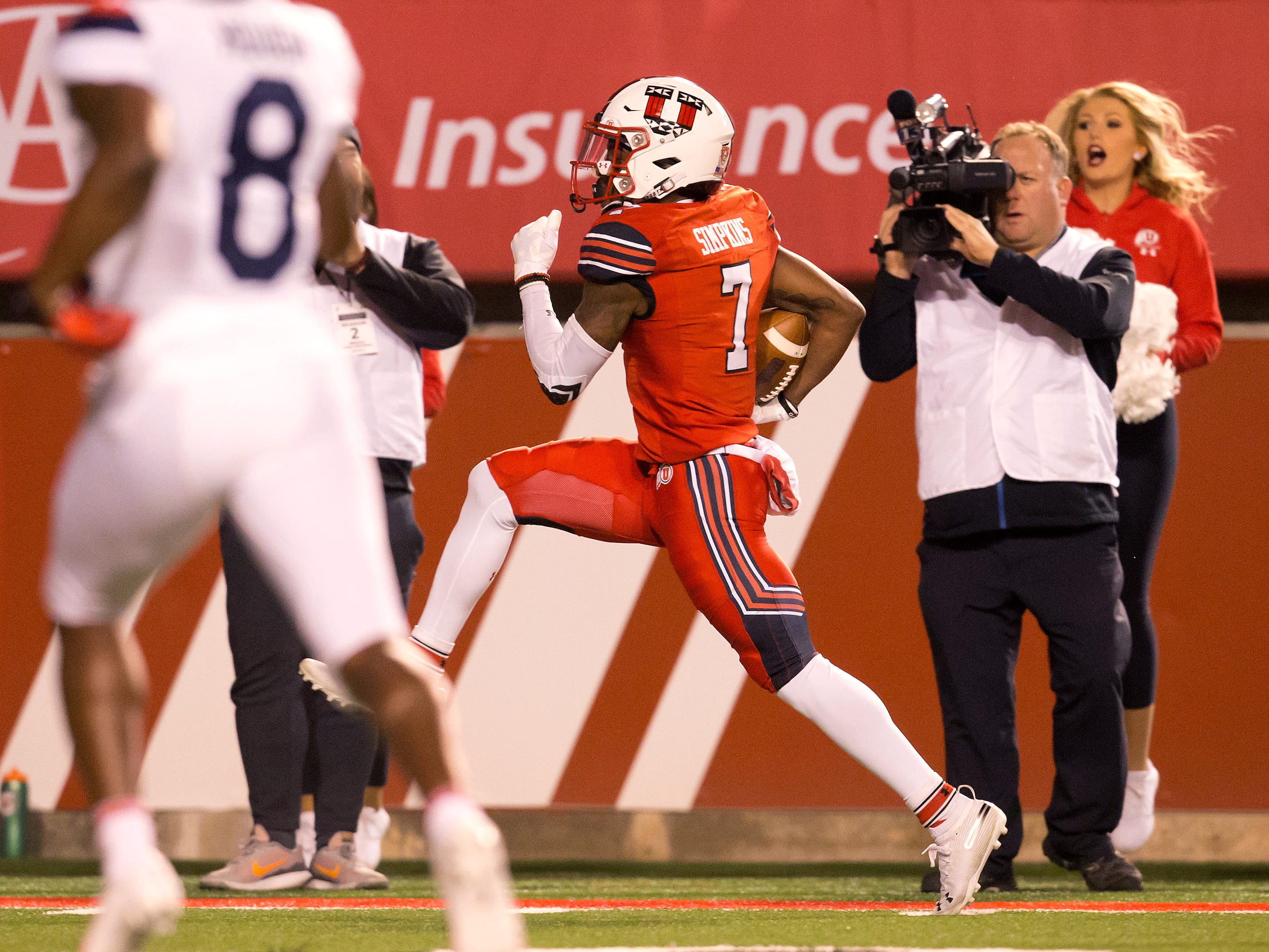 Oct 12, 2018; Salt Lake City, UT, USA; Utah Utes wide receiver Demari Simpkins (7) runs for a touchdown after a reception during the first half against the Arizona Wildcats at Rice-Eccles Stadium.
