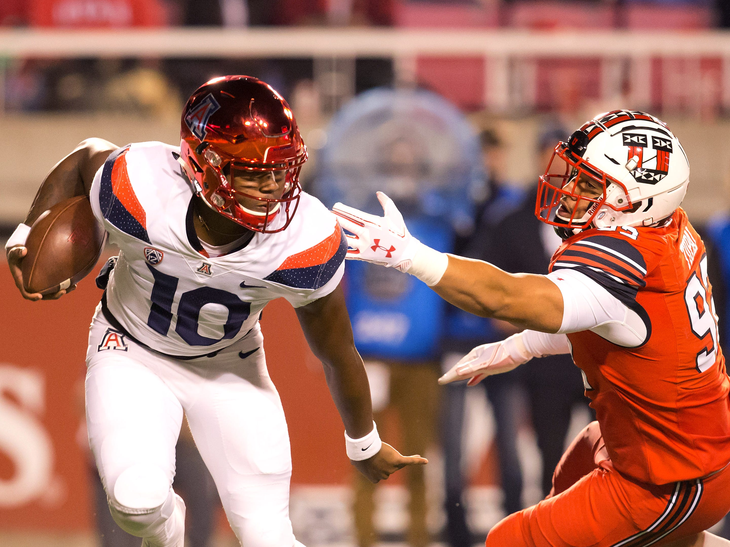 Oct 12, 2018; Salt Lake City, UT, USA; Arizona Wildcats quarterback Jamarye Joiner (10) avoids the tackle of Utah Utes defensive end Maxs Tupai (92) during the first half at Rice-Eccles Stadium.