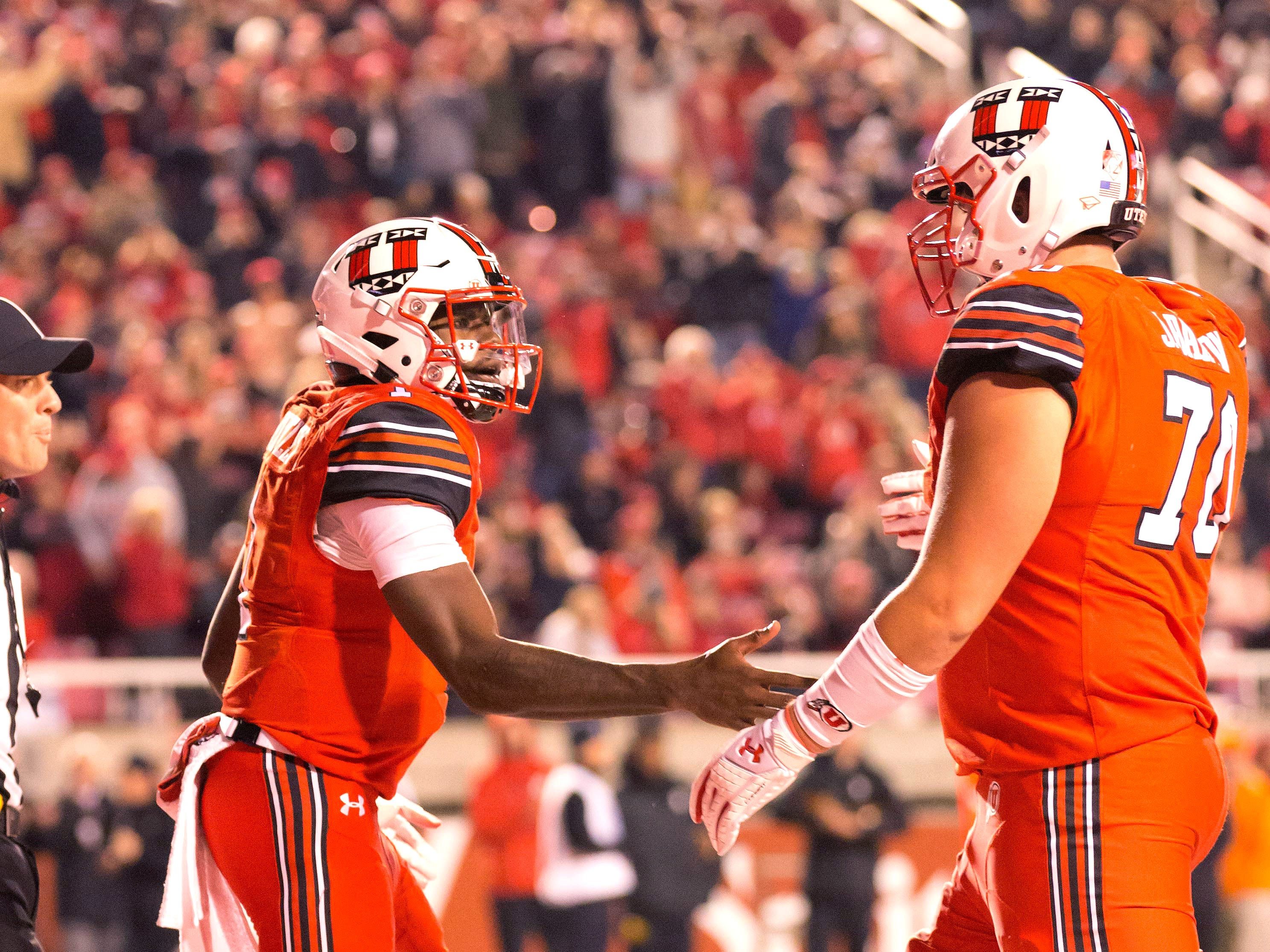 Oct 12, 2018; Salt Lake City, UT, USA; Utah Utes quarterback Tyler Huntley (1) and offensive lineman Jackson Barton (70) react after a touchdown during the first half against the Arizona Wildcats at Rice-Eccles Stadium.