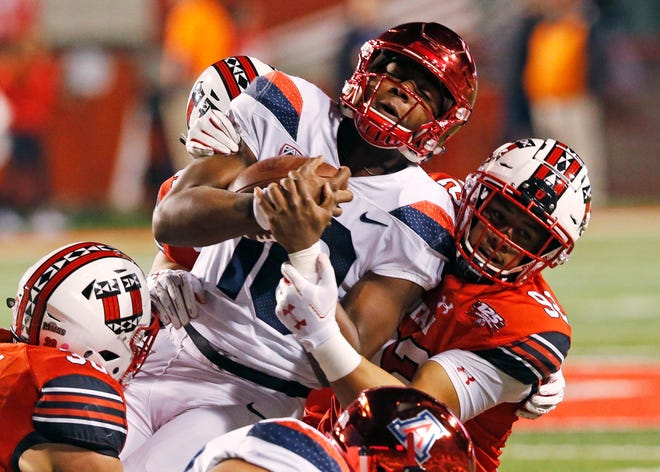 Utah defensive end Maxs Tupai, right, tackles Arizona quarterback Jamarye Joiner (10) during the first half of an NCAA college football game Friday, Oct. 12, 2018, in Salt Lake City.