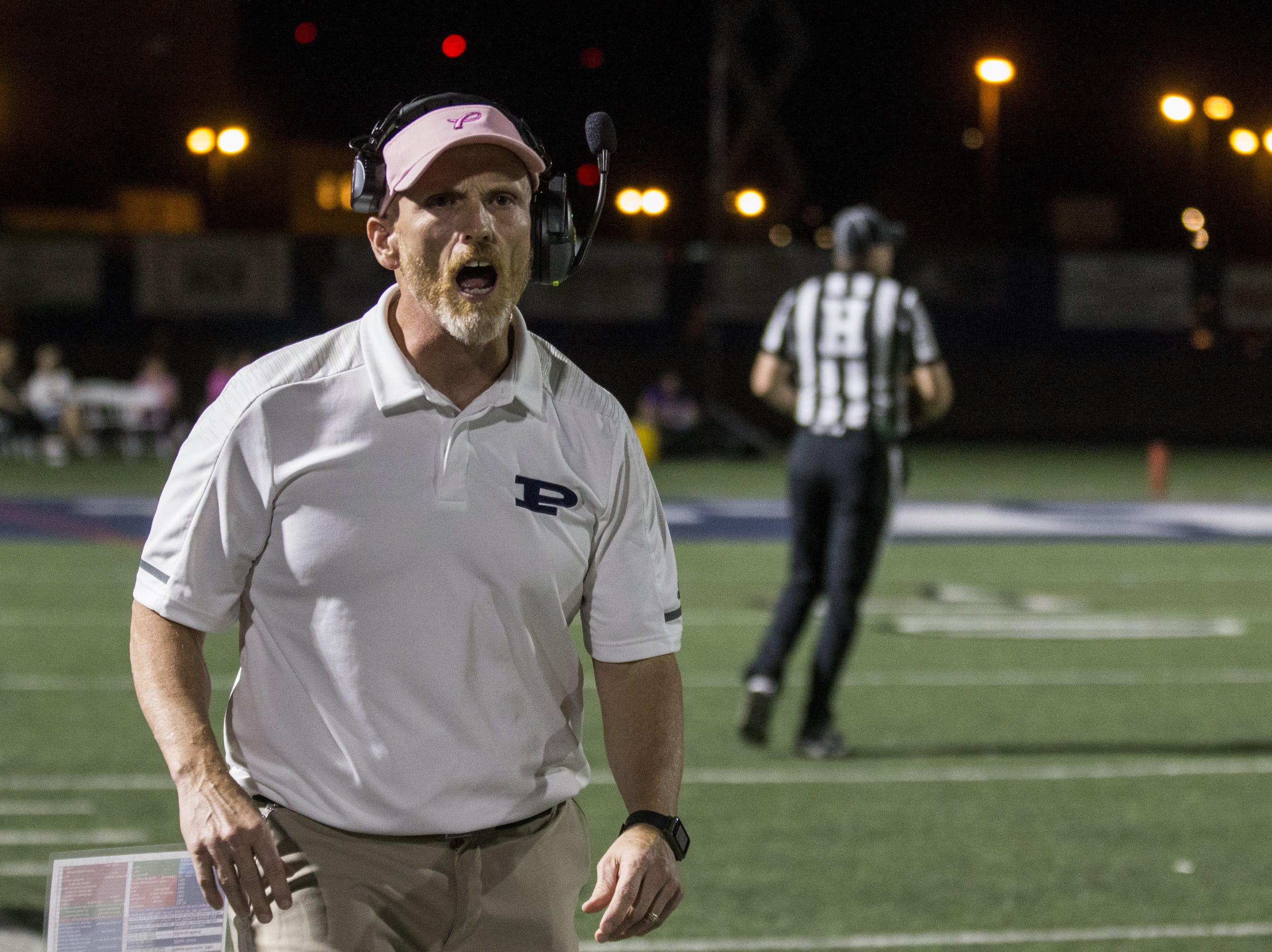 Pinnacle head coach Dana Zupke shouts during the game against Liberty on Friday, Oct. 12, 2018, at Pinnacle High School in Phoenix.  #azhsfb