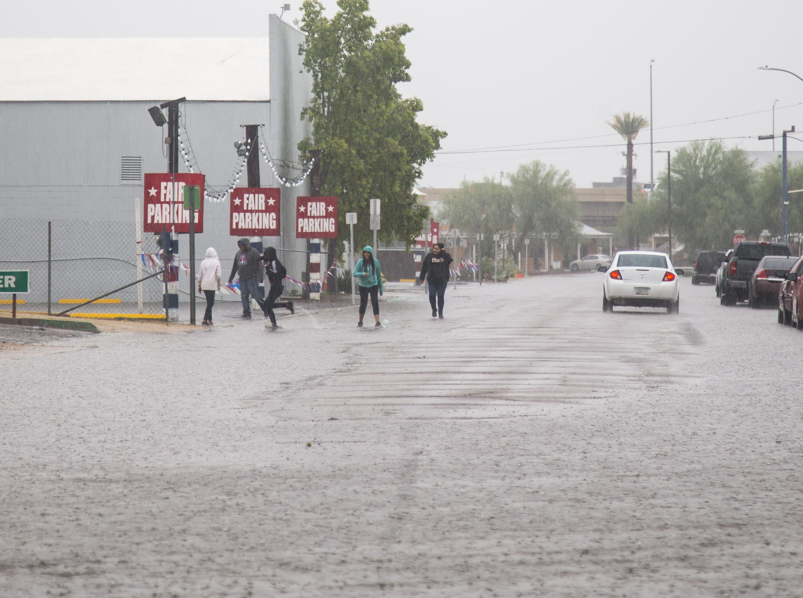 Rain hits the valley flooding streets near the Arizona State Fair in Phoenix on October 13, 2018.