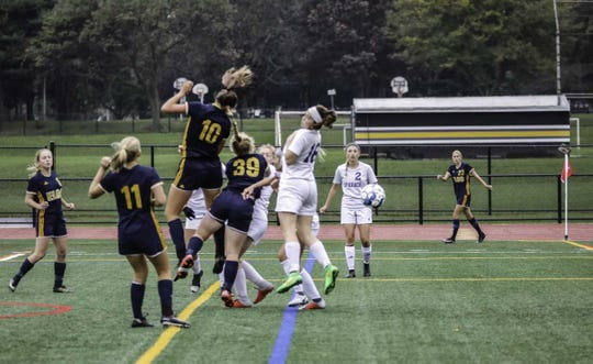 Ryelle Shuey (10) heads the ball in for Elco's first goal on Friday.
