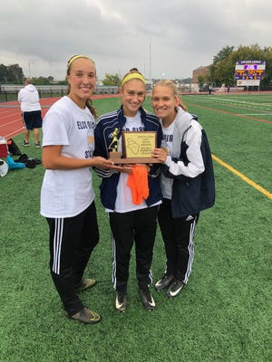 Elco captains, from left, Ryelle Shuey, Jordan Rosengrant and Julia Nelson accept the Section 3 championship trophy prior to Saturday's L-L League playoff win over Ephrata