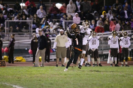 Palmyra's Sean Carter (1) caught six passes on Friday night in the Cougars' 28-14 loss to Milton Hershey.