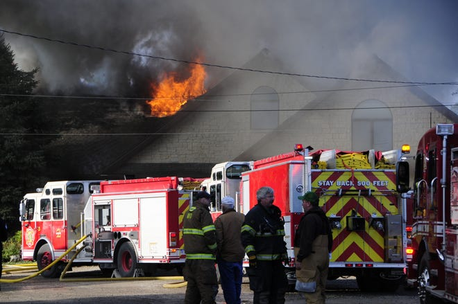 A large house is on fire at Rattle Run and Gratiot.