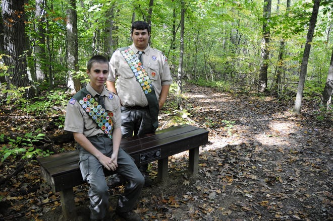 Brent, seated, and Brian Cadreau completed Eagle Scout projects that included building a shelter for horses and benches for the nature trail at Greig Park in St. Clair.