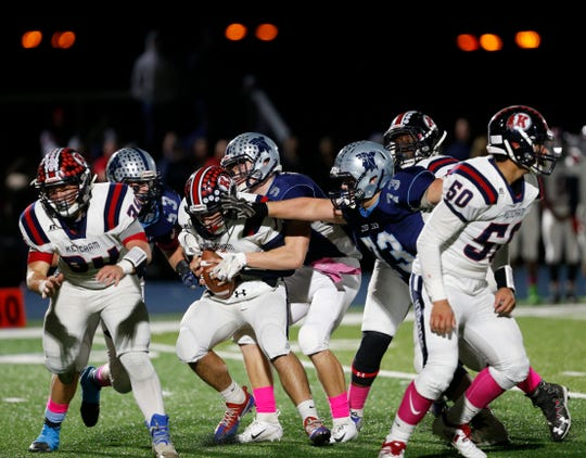 John Jay defensive players, including Joe Griggs (No. 73), converge on a Ketcham ball carrier during an Oct. 12 game.