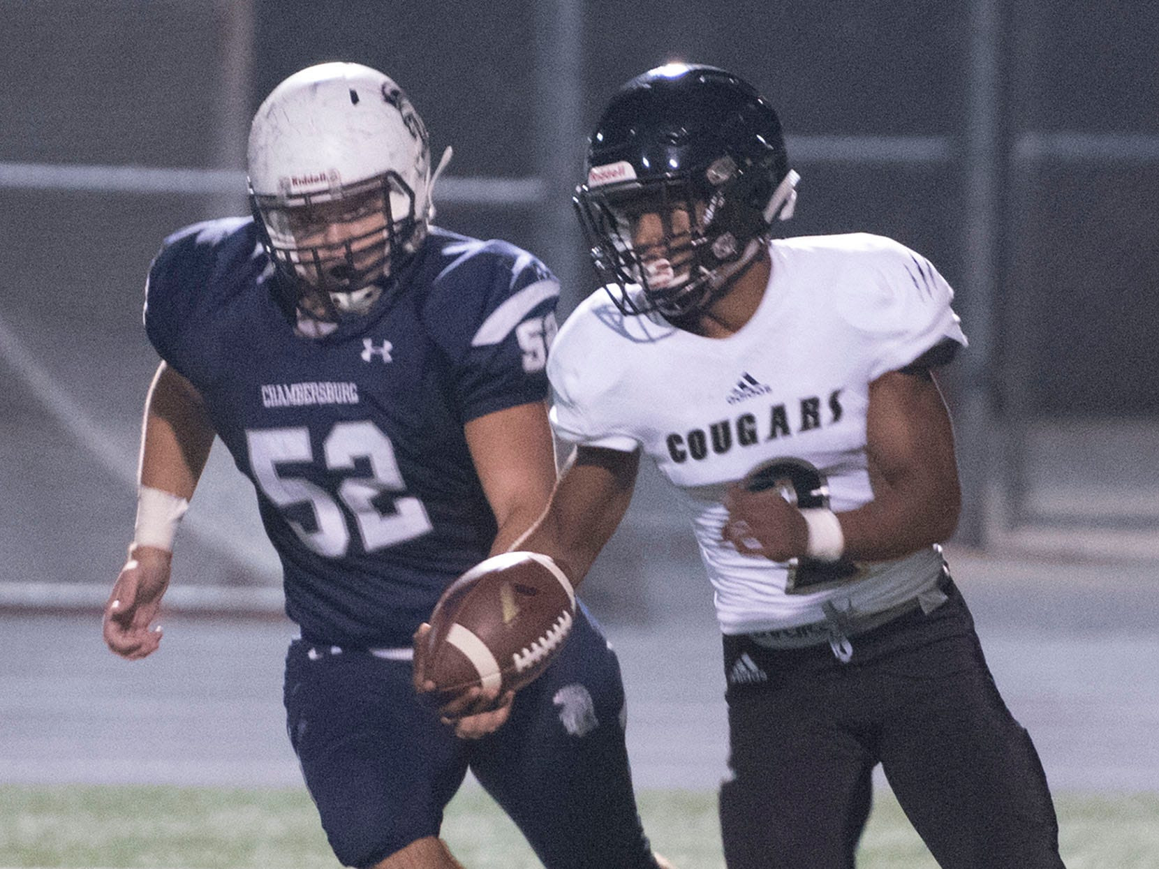 Chambersburg's Wyatt Hull (52) chases ball carrier Rynell Gantt, Jr. Chambersburg dropped a 28-13 game against Harrisburg in PIAA football on Friday, Oct. 12, 2018.