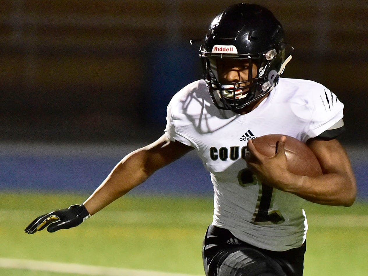 Harrisburg's Rynell Gant takes off for the Cougars. Chambersburg dropped a 28-13 game against Harrisburg in PIAA football on Friday, Oct. 12, 2018.