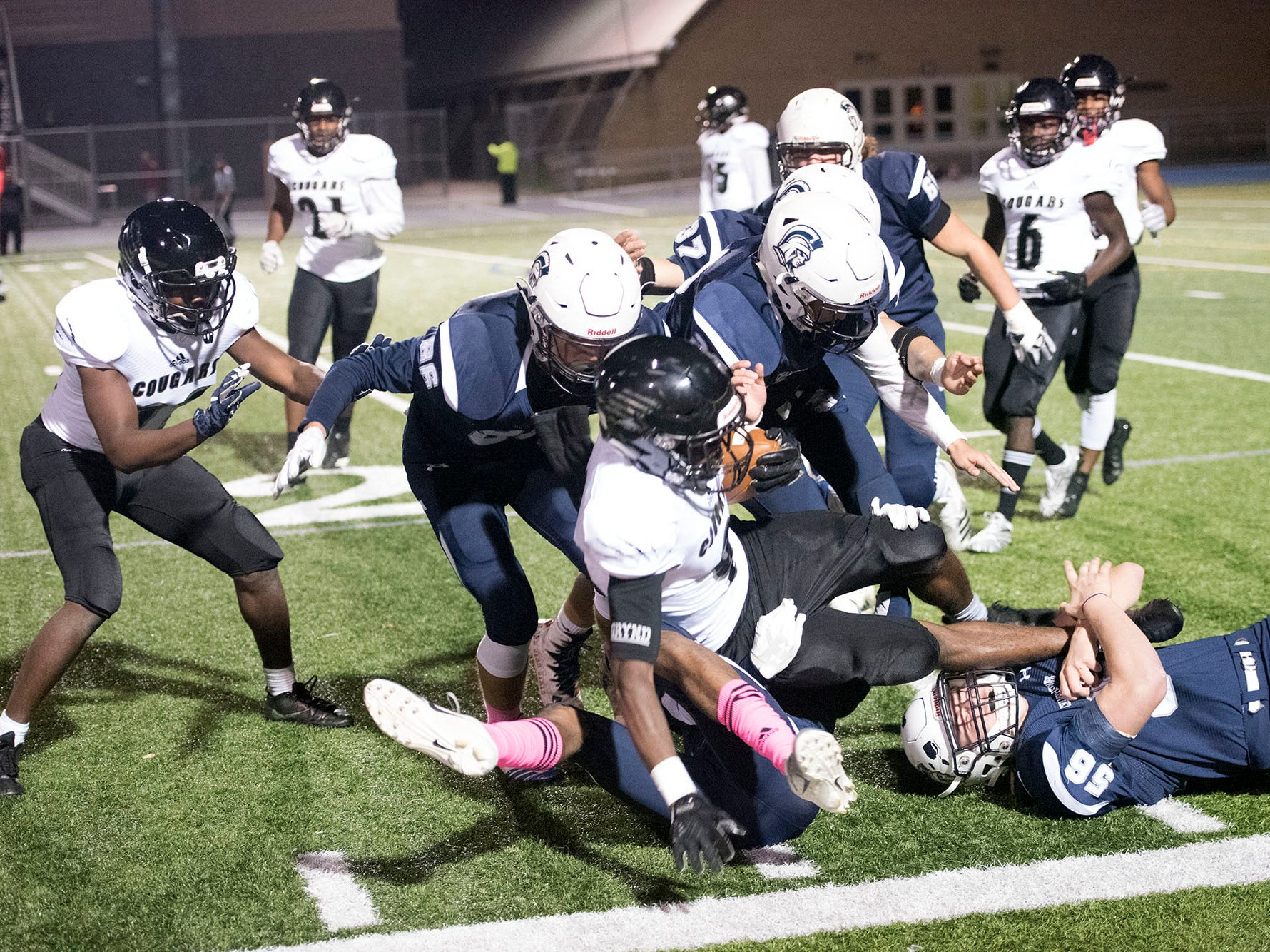 Harrisburg' Donte Kent runs the ballet before being tackled by a host of Chambersburg defenders. Chambersburg dropped a 28-13 game against Harrisburg in PIAA football on Friday, Oct. 12, 2018.