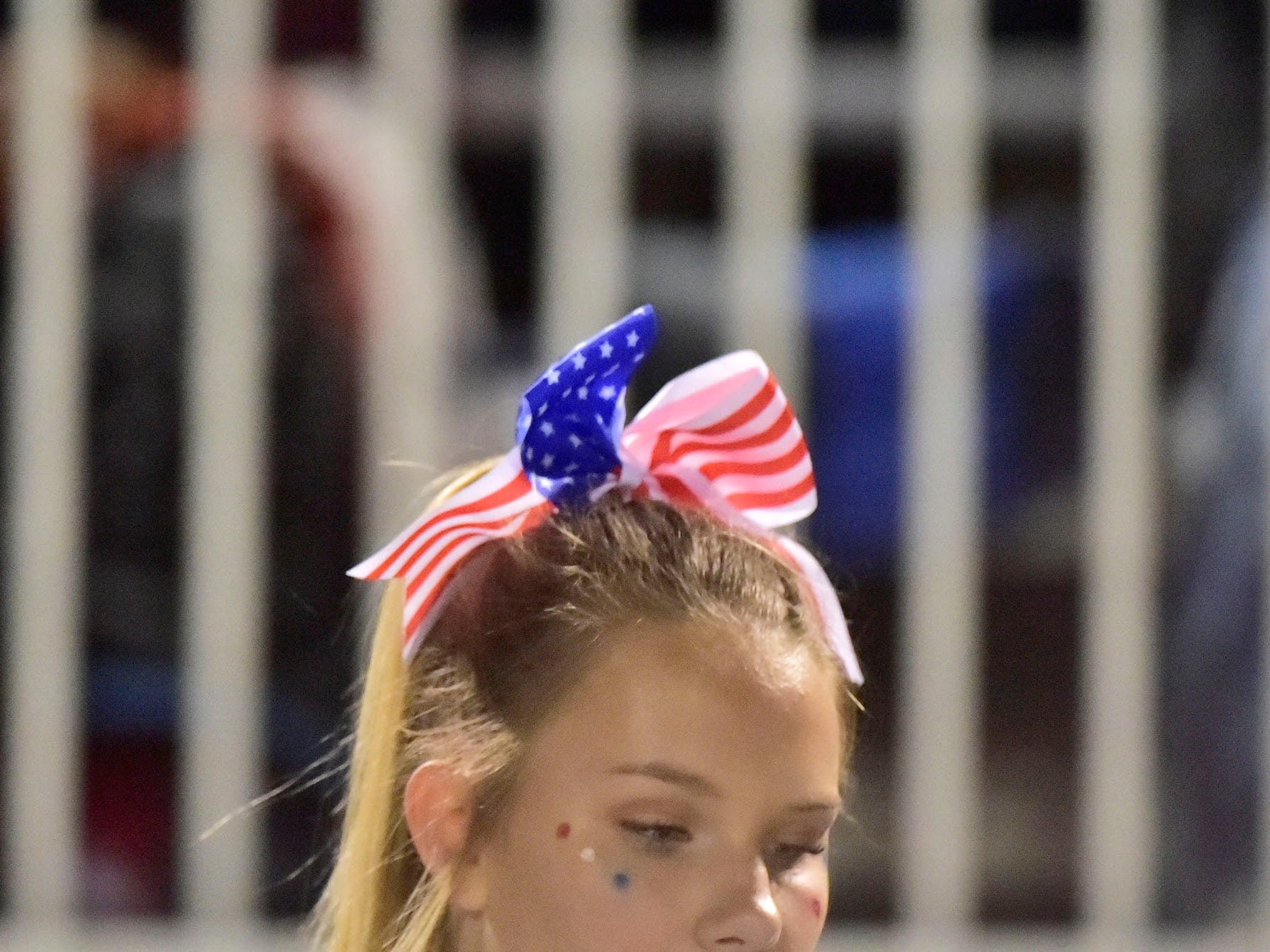 A Chambersburg cheerleader wears a U.S. flag inspired bow. Chambersburg dropped a 28-13 game against Harrisburg in PIAA football on Friday, Oct. 12, 2018.