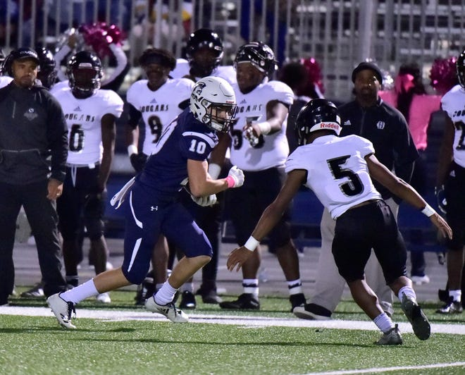 Chambersburg's Brady Hughes is on the run for the Trojans. Chambersburg dropped a 28-13 game against Harrisburg in PIAA football on Friday, Oct. 12, 2018.