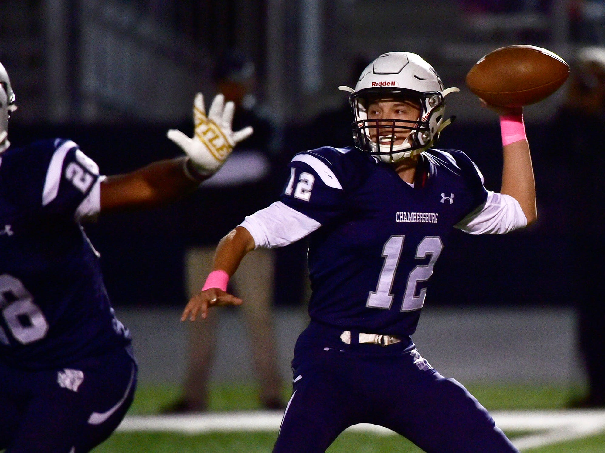 Chambersburg's Brady Stumbaugh drops back to pass the ball Chambersburg dropped a 28-13 game against Harrisburg in PIAA football on Friday, Oct. 12, 2018.