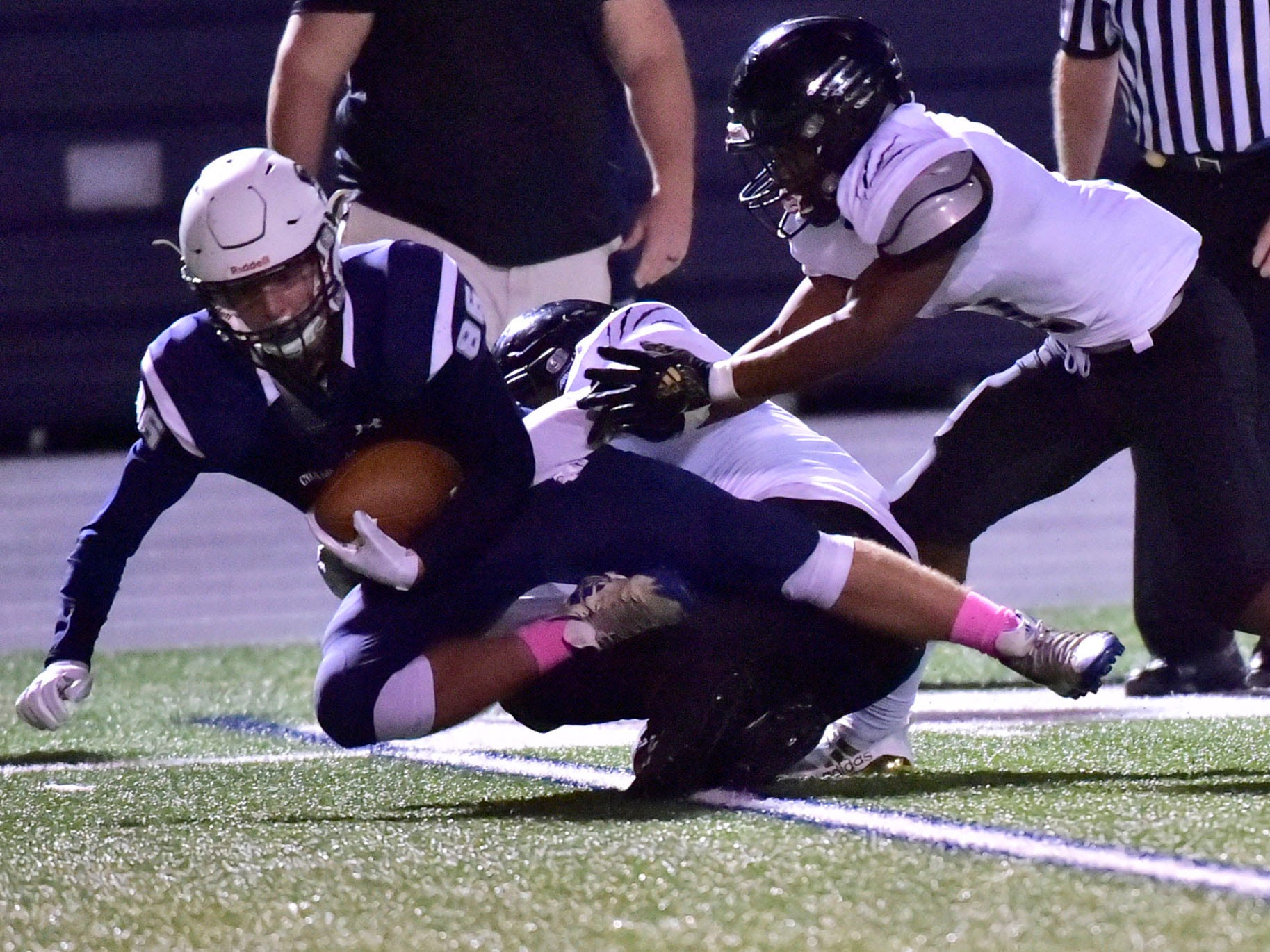Alex Lapinski (86) catches a pass and is tackled by Harrisburg. Chambersburg dropped a 28-13 game against Harrisburg in PIAA football on Friday, Oct. 12, 2018.