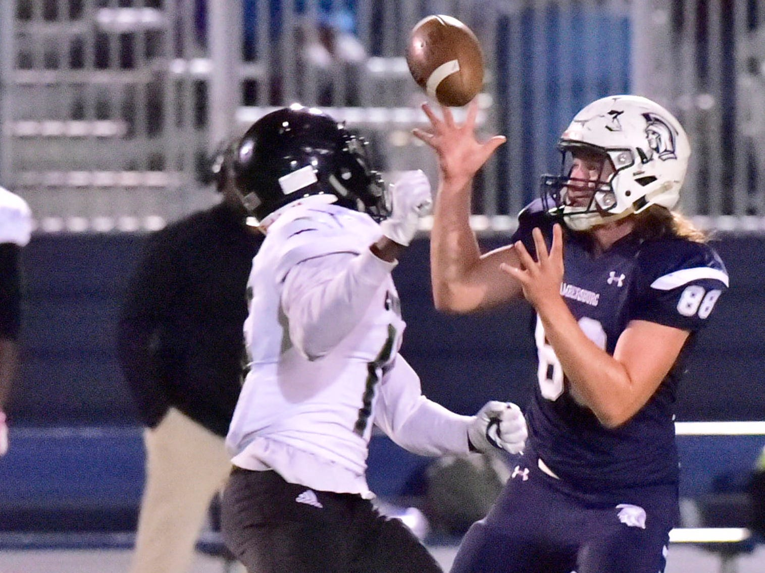 Chambersburg's Garner Funk (88) reels in a pass for the Trojans. Chambersburg dropped a 28-13 game against Harrisburg in PIAA football on Friday, Oct. 12, 2018.