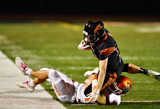 Central York's Anthony Tsirigos pulls down Northeastern's Robby Elzinga during football action at Northeastern Senior High School in Manchester, Friday, Oct. 12, 2018. Central York would win the game 44-7. Dawn J. Sagert photo