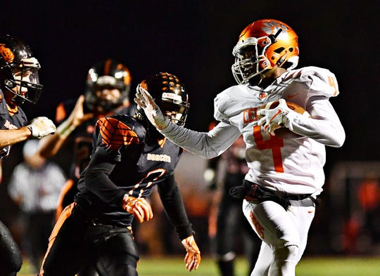 Central York's Saahir Cornelius, right, ranks seventh in yards per reception in the league at 22.1. DISPATCH FILE PHOTO